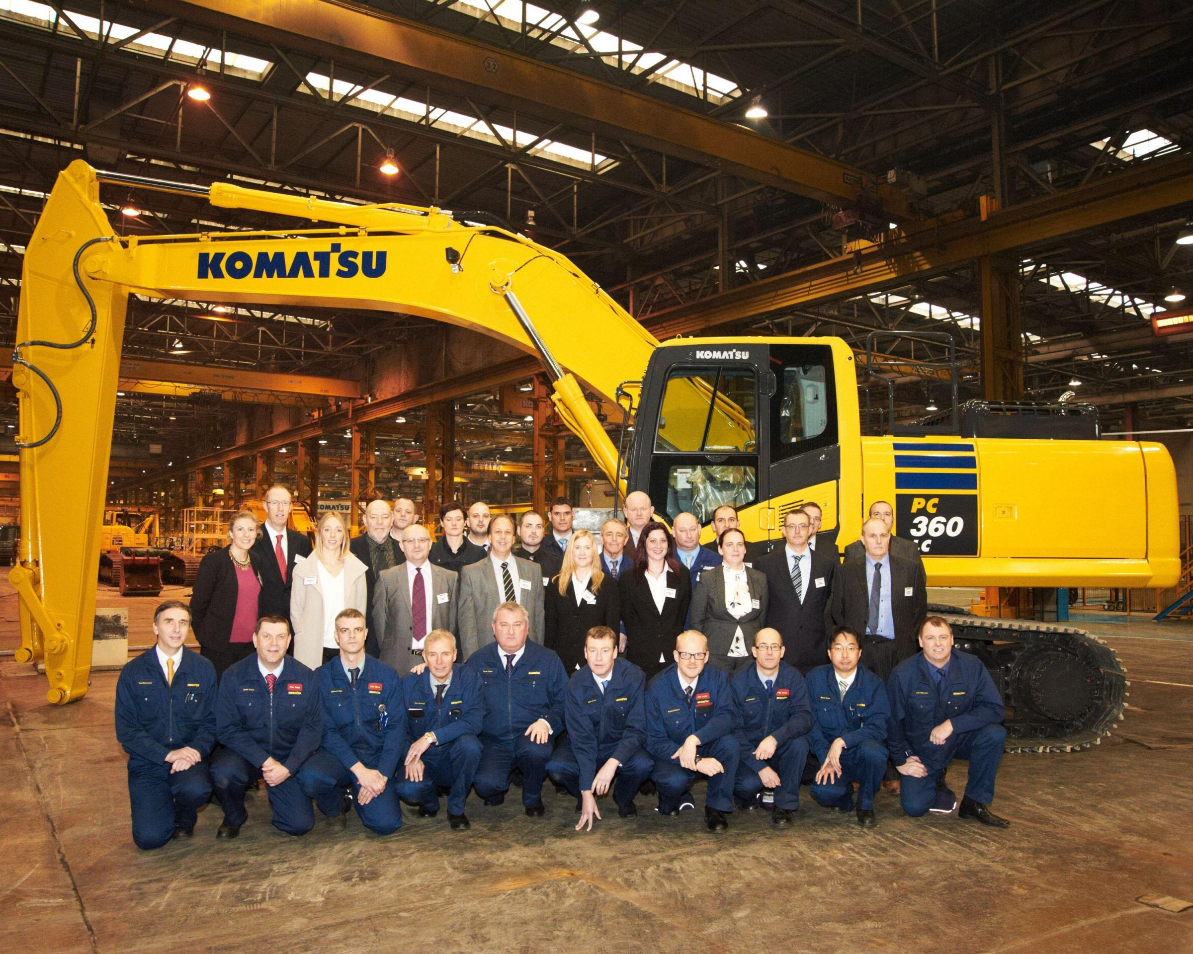 Komatsu UK workers and supply chain representatives, who helped with the US