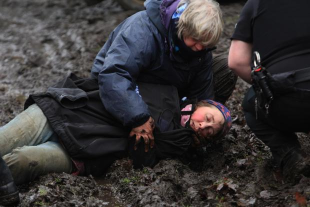The dramatic moment the distraught owner of Rainbow Ark Animal Sanctuary collapsed as she was overcome with grief after the arrival of bailiffs