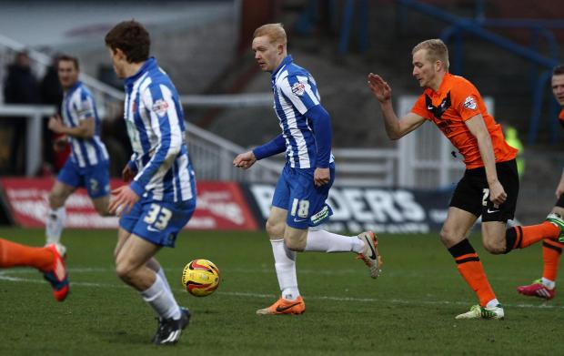 PUSHING ON: Luke Williams, centre, on the attack for Hartlepool against Scunthorpe on Saturday