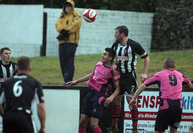 The Northern Echo: HIGH CHALLENGE: Amar Purewal jumps for the ball with Kendal Town's Ricky Mercer