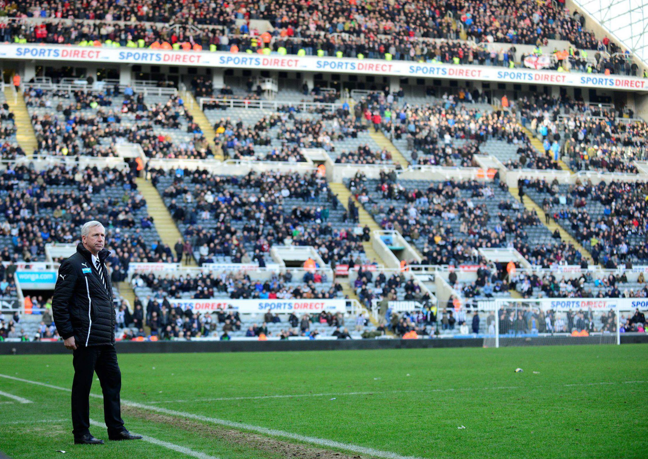 LONELY PLACE: Newcastle manager Alan Pardew watches amid a half full St James' Park after watching his side concede a third goal against Sunderland on Saturday
