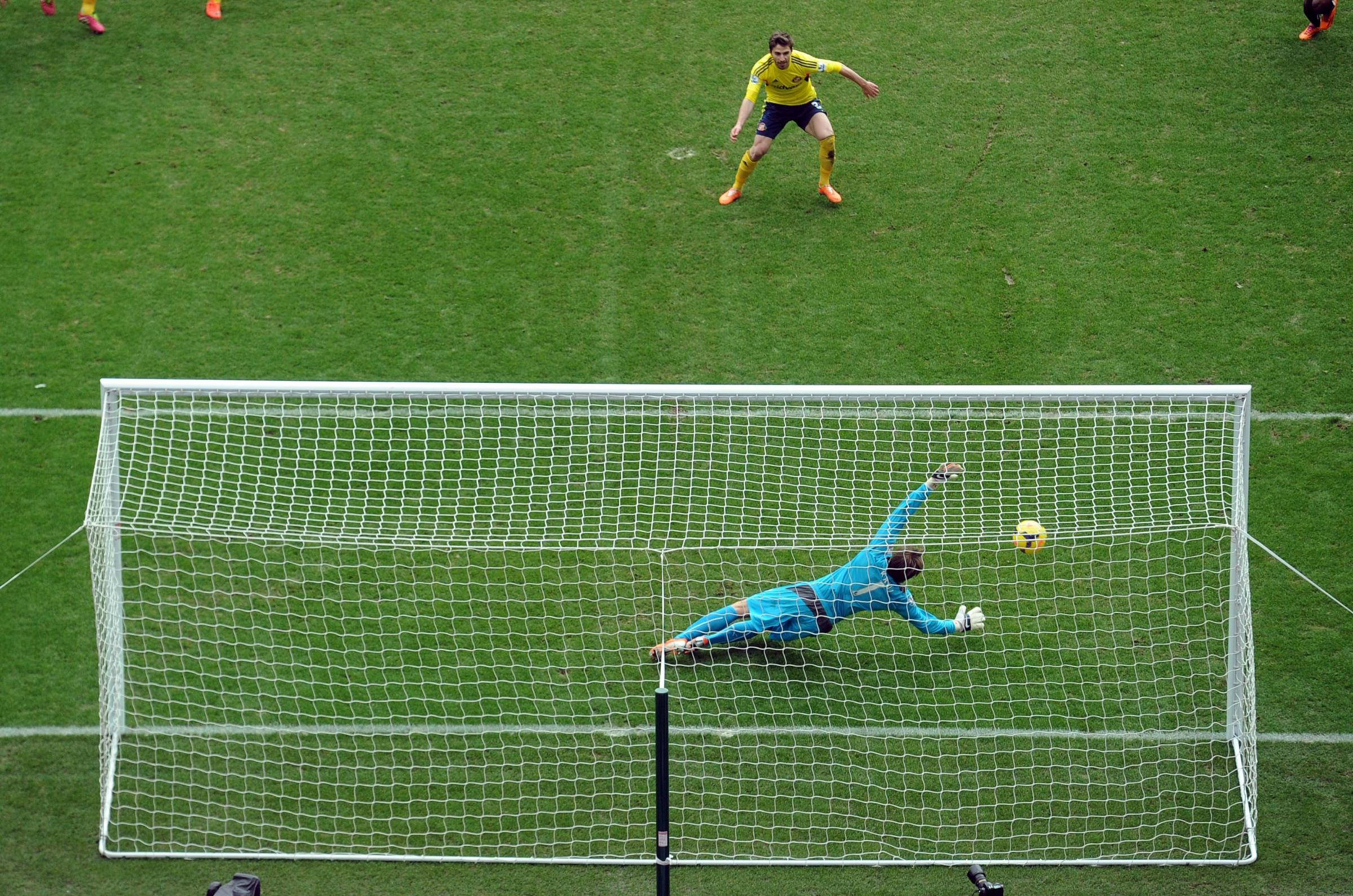 DESPAIRING DIVE: Newcastle goalkeeper Tim Krul can't prevent Fabio Borini putting Sunderland ahead from the penalty spot on Saturday