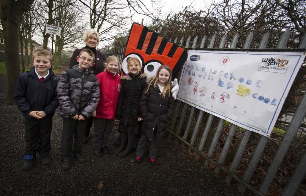 (L to R) Billy Richardson, Joseph Patton, Megan Hauxwell, Grace Garland and Daisy Middlesmas, with Councillor Andrea Patterson and Strider, the Walk to School mascot.