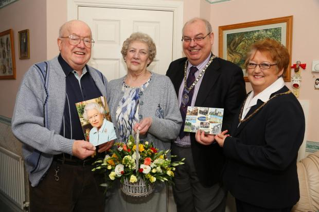 The Northern Echo: Rosa and Ronnie Stewart  (left) receive a basket of flowers from the Deputy Chairman of Durham Cou