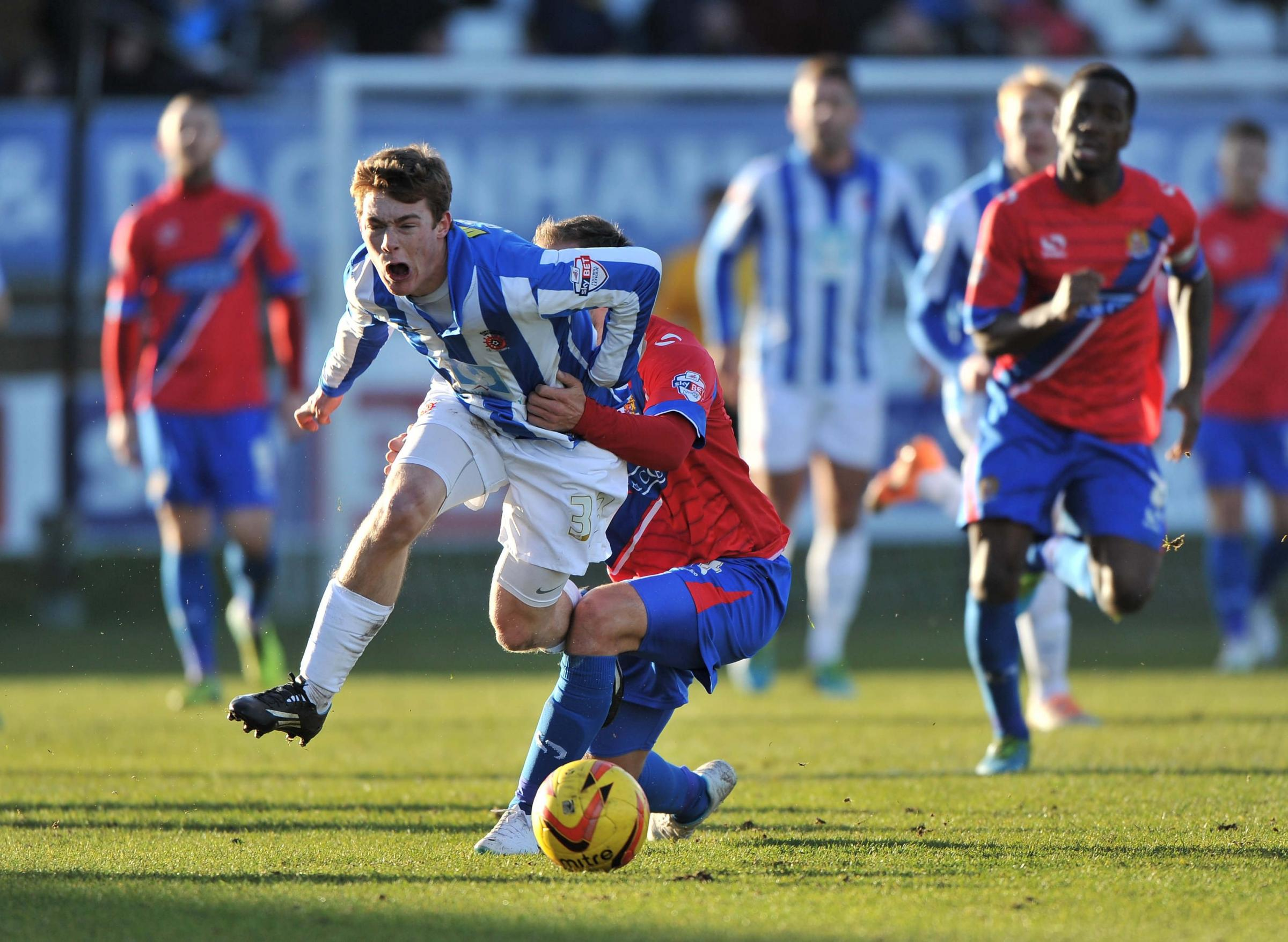 PULLED BACK: Luke James is fouled by Scott Doe, of Dagenham and Redbridge