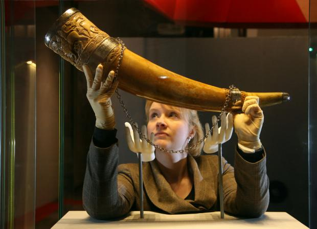 Vicky Harrison, collections manager for York Minster puts the Horn of Ulph in its display case