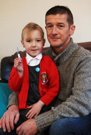 Barry Barkess, of Stanley, pictured with his daughter Holly Price, five, who saved her father's life by giving him an injection. Pic: Sarah Caldecott