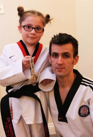 Grace Perez, nine, pictured with her father, Andrew Grace, got a bronze in the NTC Open and Andrew got a silver. Pic: Sarah Caldecott