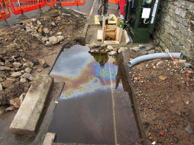 WATER-FILLED HOLE: A hole left by contractors for BT outside Grove House bed and breakfast in Leyburn