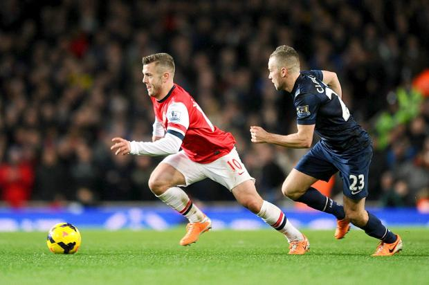 MATCHING MIDFIELDERS: Jack Wilshere and Tom Cleverley match each other as they contest possession during last night's 0-0 draw between Arsenal and Manchester United