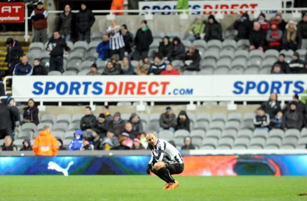 THAT SINKING FEELING: Newcastle's Yoan Gouffran after being thumped by Tottenham Hotspur