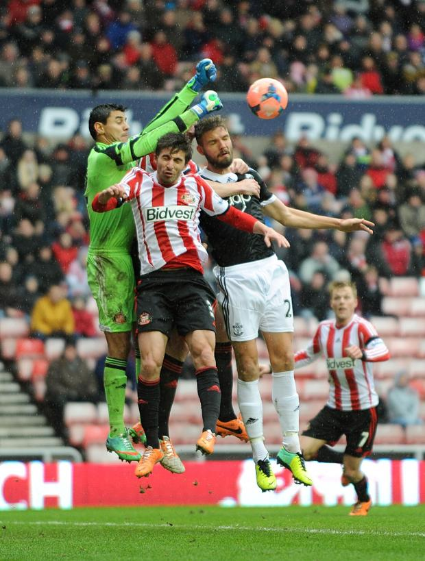The Northern Echo: KEEPER'S BALL: Southampton goalkeeper Kelvin Davis punches the ball away from Fabio Borini's challenge