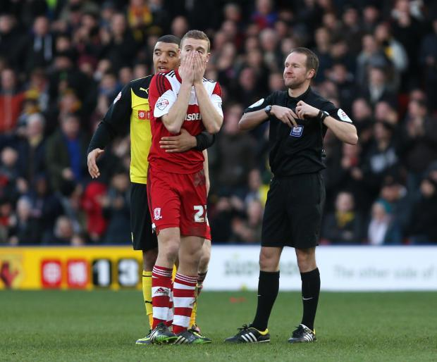 OFF YOU GO: Ben Gibson receives a red card for a second bookable offence