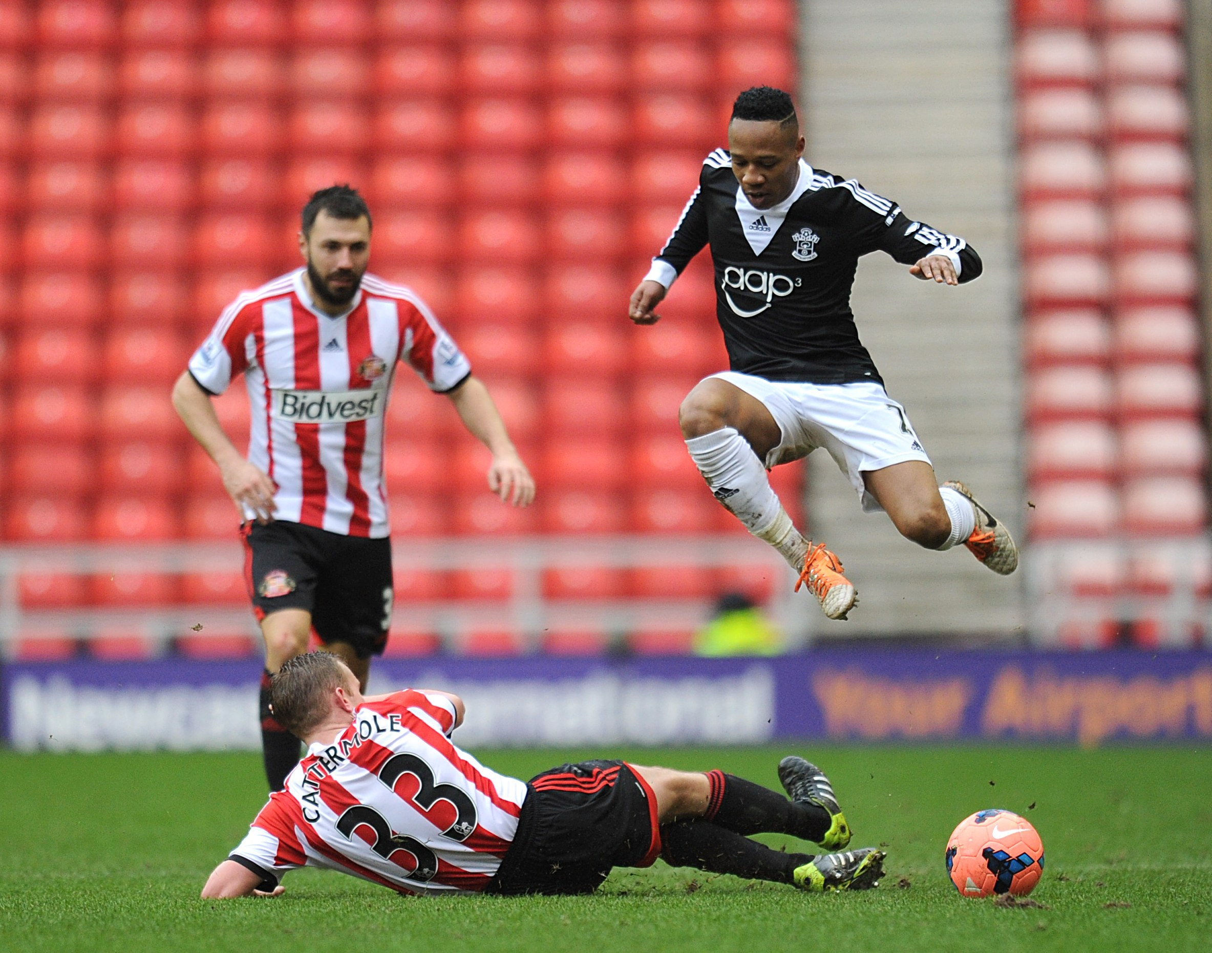 STARS OF THE SHOW: Lee Cattermole puts in a challenge on Southampton's Luke Shaw as Andrea Dossena looks on