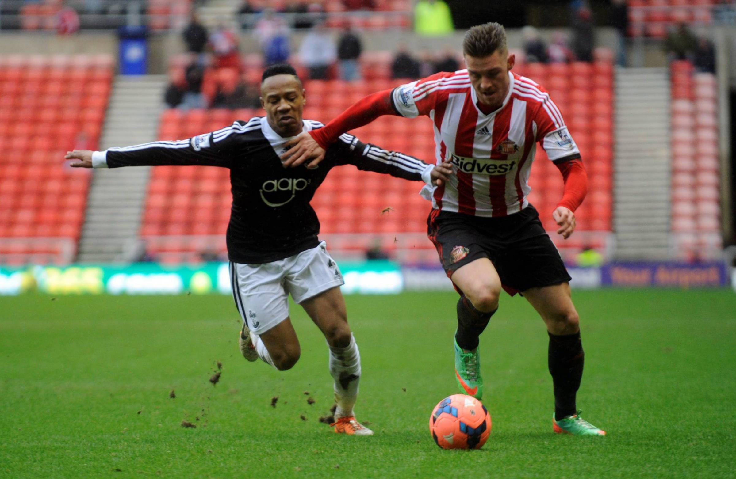 POINT TO PROVE: Sunderland's Connor Wickham sprints past Nataniel Clyne during the FA Cup 5th Round match between Sunderland and Southampton at the Stadium of Light