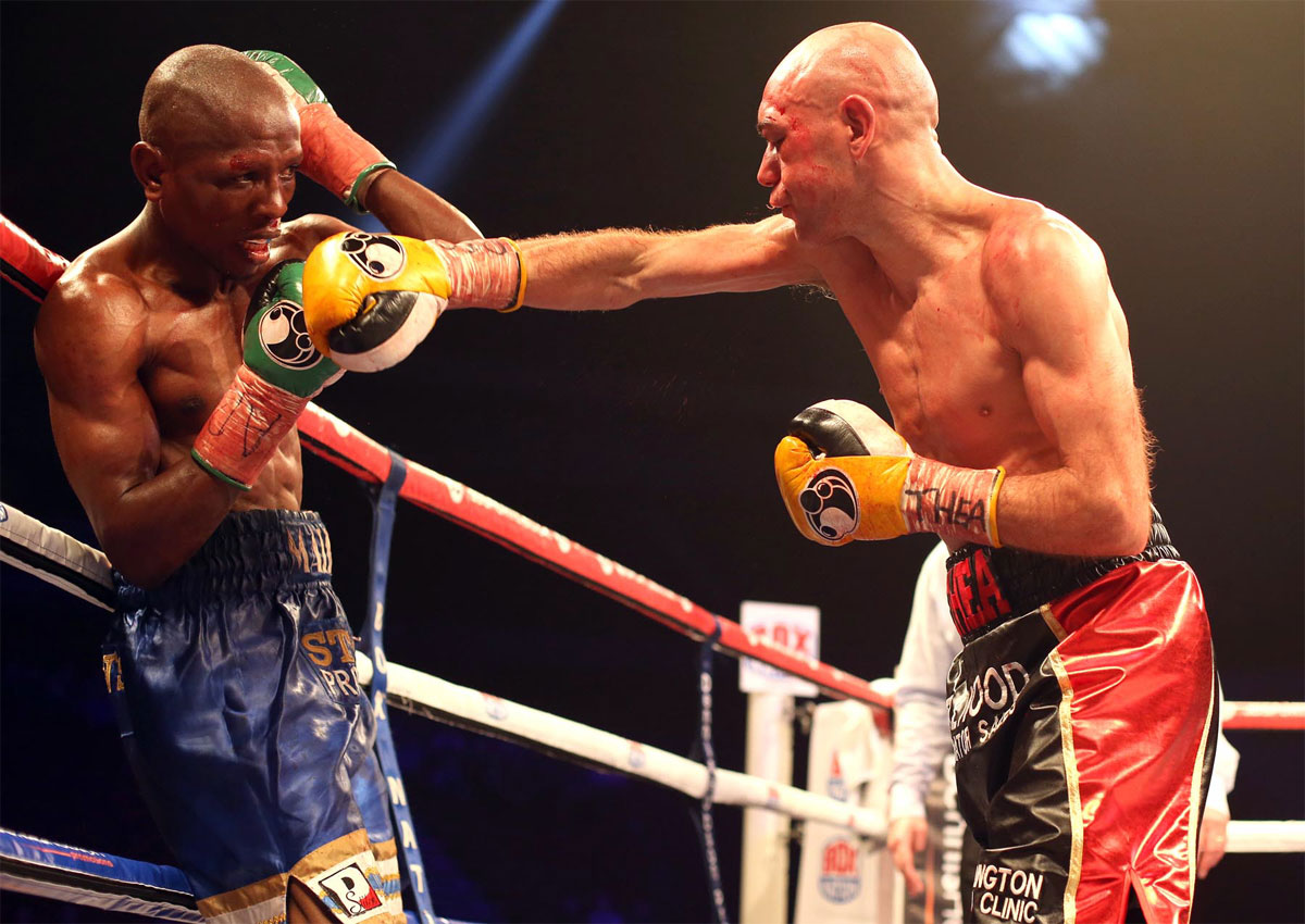 LOOKING GOOD: Stuart Hall lands a blow on Vusi Malinga during their world title fight in December. The Darlington boxer defends his title next month and s