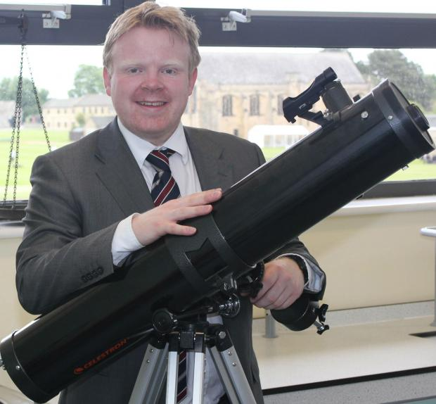 Barnard Castle physics teacher Steve Wrathmall, pictured with a powerful telescope, is interested in the big picture.