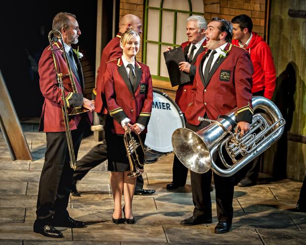 ON STAGE: Cast members of Brassed Off in York. The tour comes to Darlington next month and the show will go on, following the withdrawal of the brass band