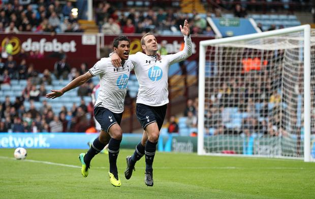 Tottenham Hotspur players Paulinho, left, and Roberto Soldado celebrate a goal wearing the club's Hewlett Packard sponsored shirts