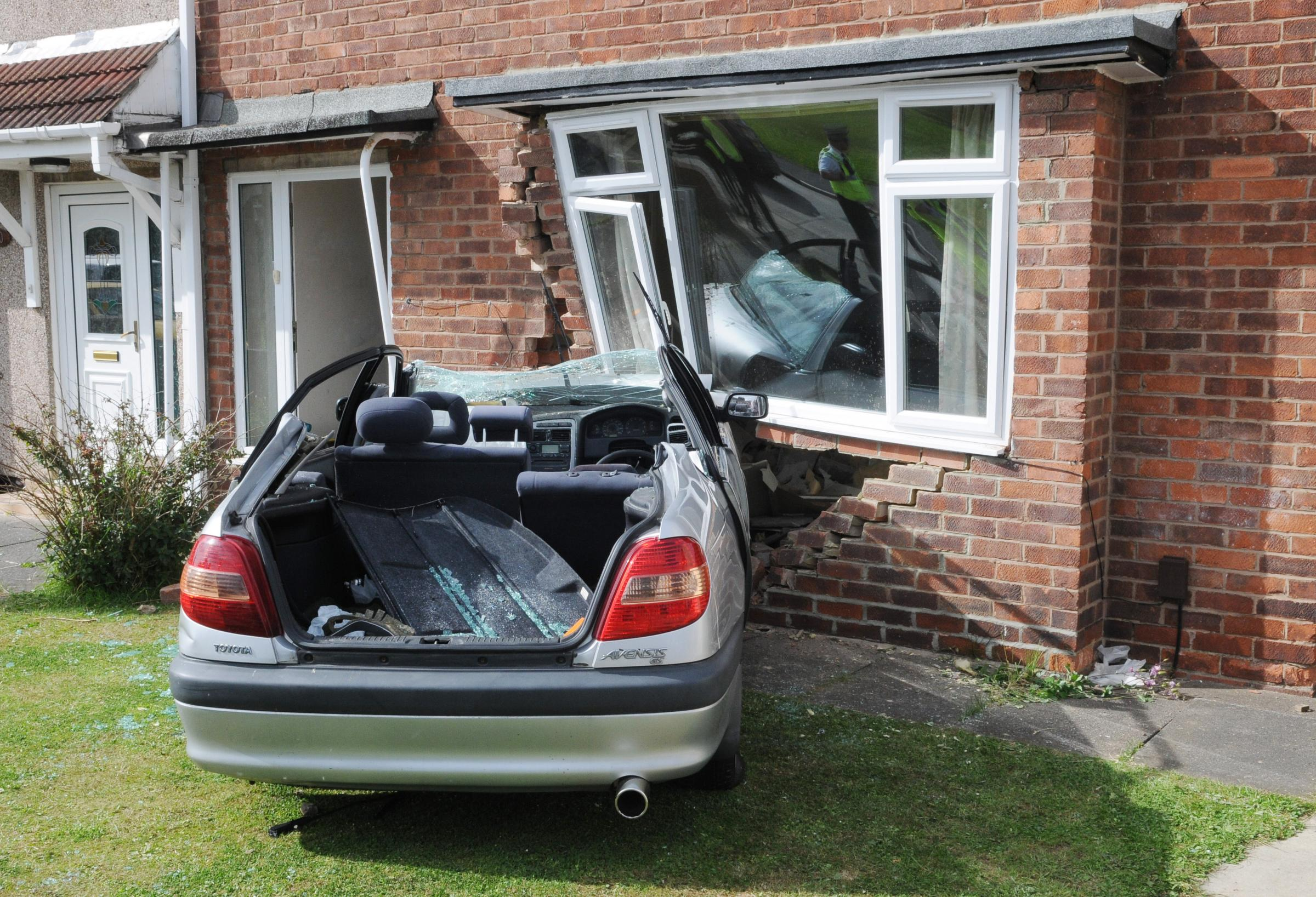 The car embedded in the house on Rostrevor Avenue
