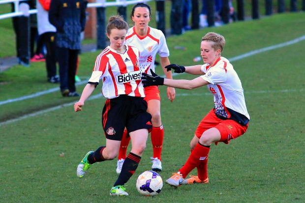 UNDER PRESSURE: Sunderland's Brogan McHugh challenged by Natasha Dowie and Lucy Bronze, of Liverpool, during last weekend's friendly game at Hetton