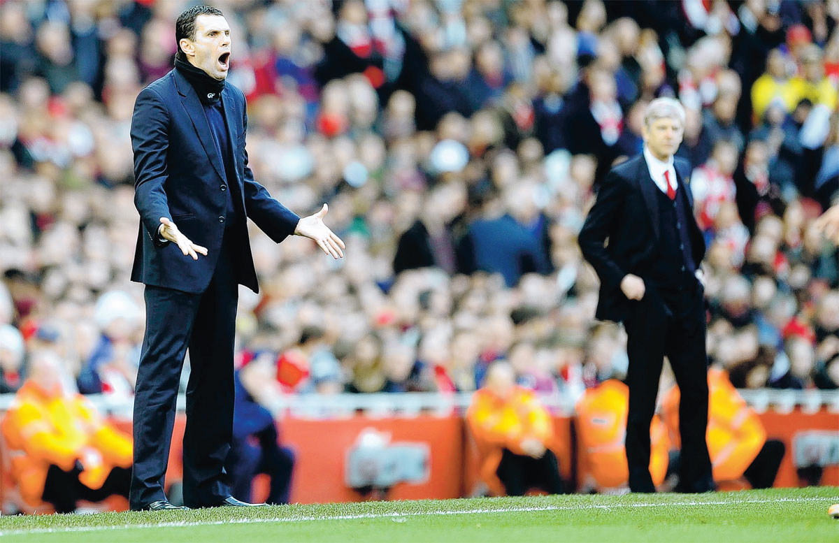 TOUCHLINE TACTICS: Sunderland manager Gus Poyet, left, and Arsenal boss Arsene Wenger patrol their technical areas at the Emirates on Saturday