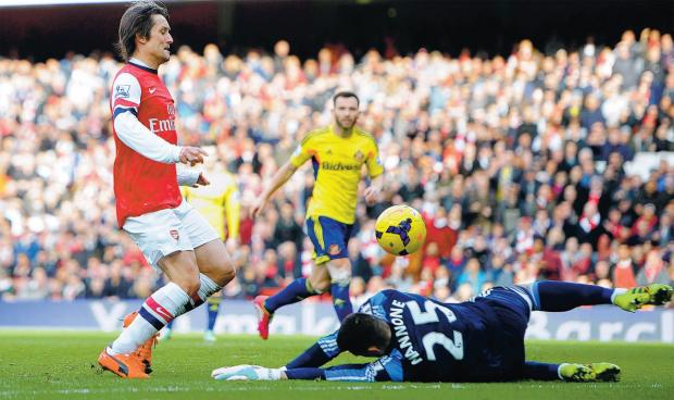 SUBLIME GOAL: Arsenal's Tomas Rosicky dinks the ball over Sunderland keeper Vito Mannone