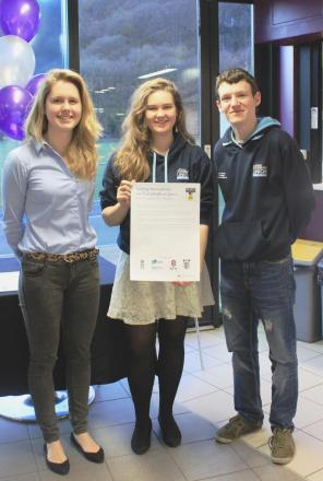 Hannah Lowther, president of Team Durham, Grace Abel, community officer at Durham Students' Union, and Dan Slavin, president of Durham Students' Union, sign the charter against homophobia and transphobia