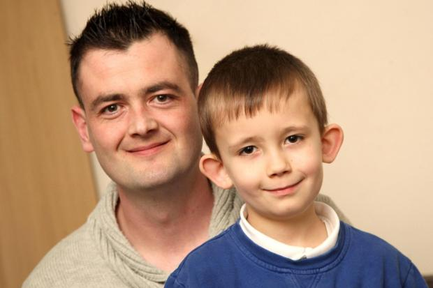 OPERATION PLANNED: Craig Watson with his son, Ashley