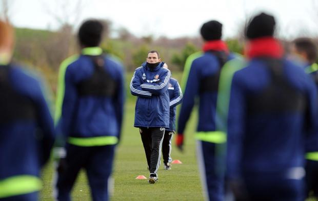 LOOKING ON: Gus Poyet watches his Sunderland side train yesterday ahead of the Capital One Cup final which takes place on Sunday