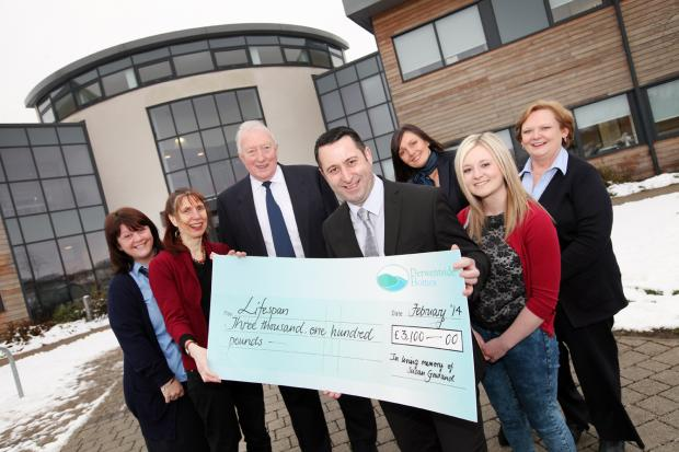 Charity Lifespan receioves the cheque from Susan Gowland's family and colleagues