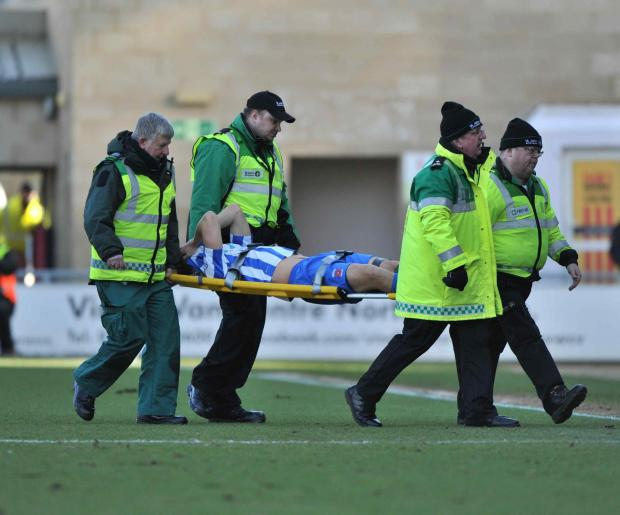 CONCERN: Michael Duckworth is carried off in last weekend's defeat at Northampton