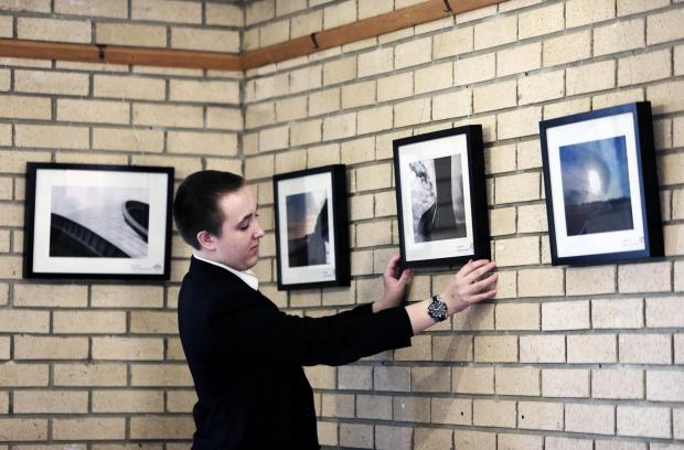 PICTURE PERFECT: 15 year old Jonathon Myers of Belmont School hangs his print in the visitors centre at Durham's Botanical Garden