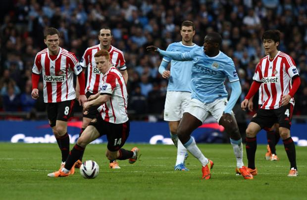 LOOKING ON: John O'Shea, back, watches Jack Colback try and evade Yaya Toure at Wembley