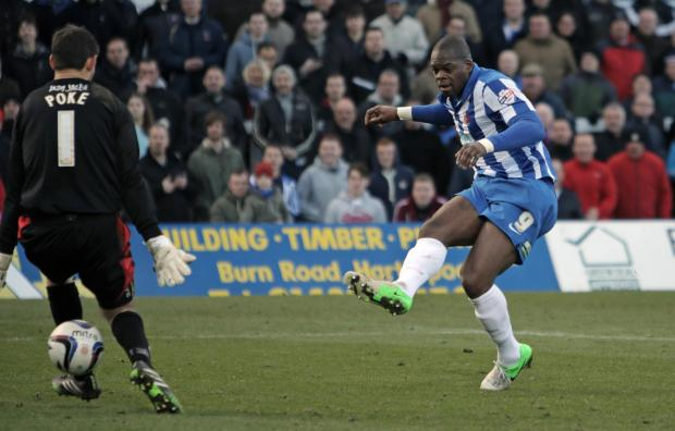 JOYFUL MOMENT: Marlon Harewood fires the ball between Michael Poke's legs for his first goal in a Pools shirt
