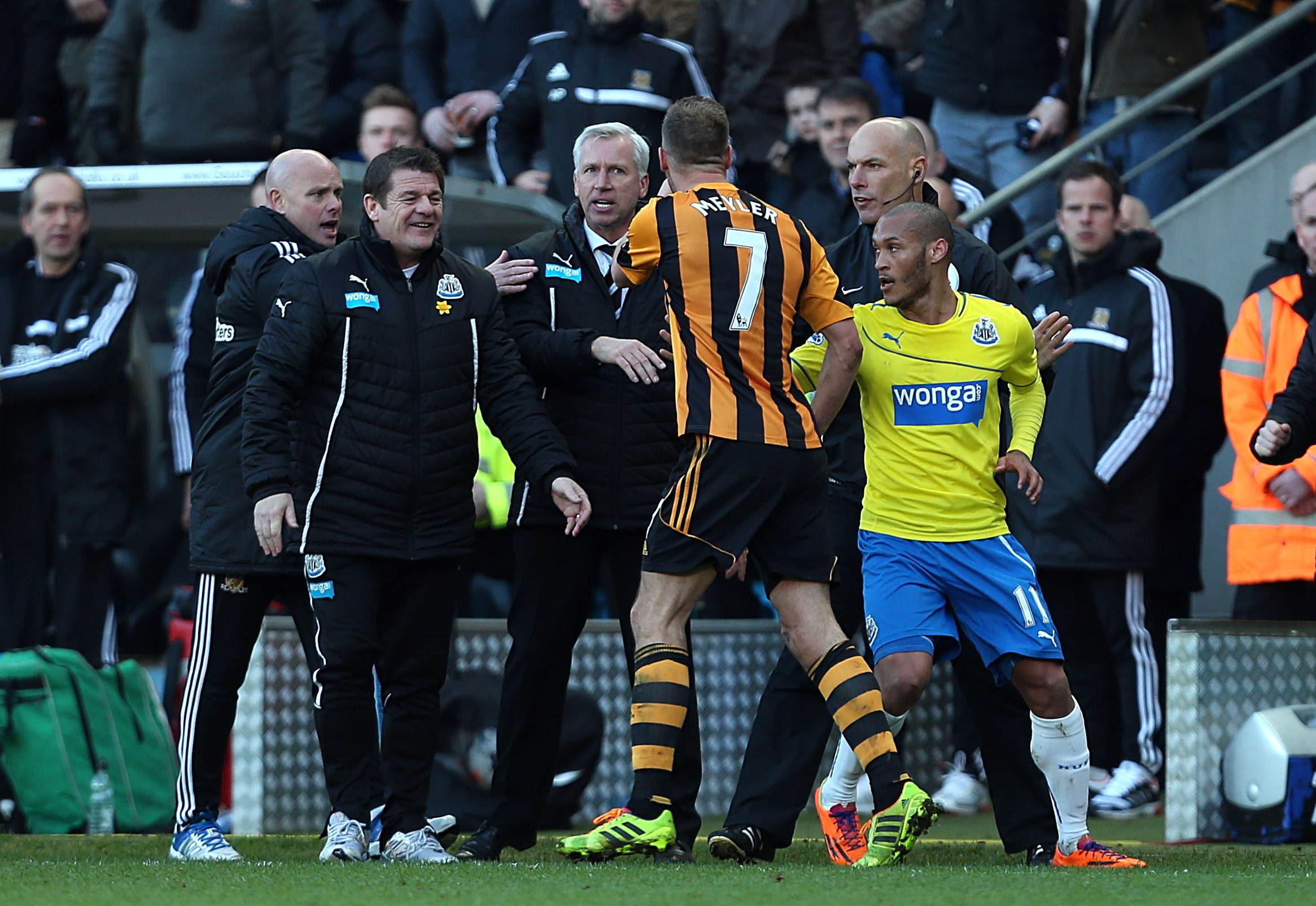 NO LAUGHING MATTER: Newcastle United assistant manager John Carver chuckles as Alan Pardew and Hull City's David Meyler confront each other on Saturday