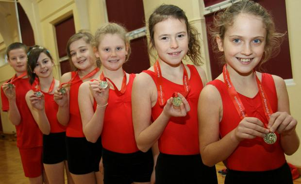 Reid Street Academy junior gymnasts with their medals.  Pictured (R-to-L):   Jessica Lewis-Kell, Tia Hoare, Jessica Brigs, Anna Gibson, Amy Manning and Ryan Chapman,  all of Darlington
