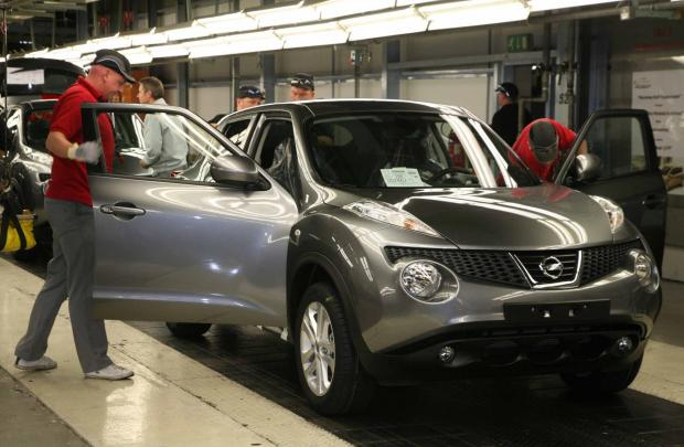 Workers at Sunderland's Nissan plant put the finishing touches to another Juke model on the production line