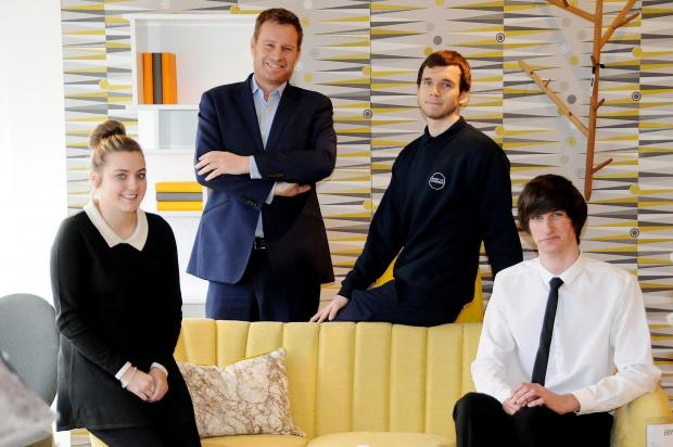 Apprentices Samantha Oram and Ellis Little, seated, with managing director James Barker, left, and Alex McKay
