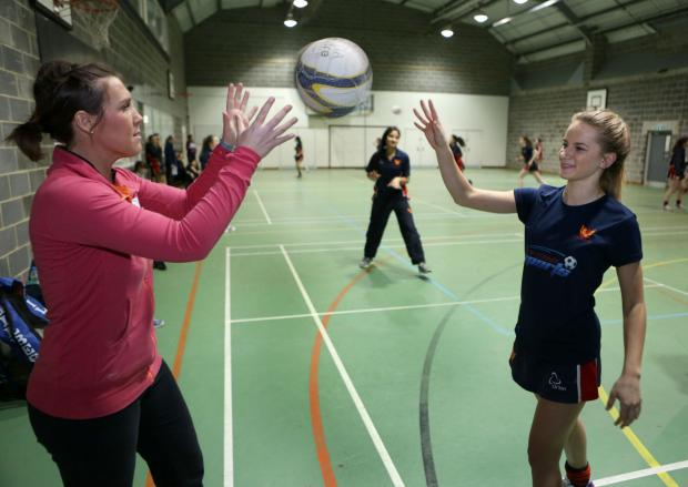 Pictured (from L-to-R): Ex-England  star Karen Greig coaches Yarm School pupil Holly Clark during a netball session