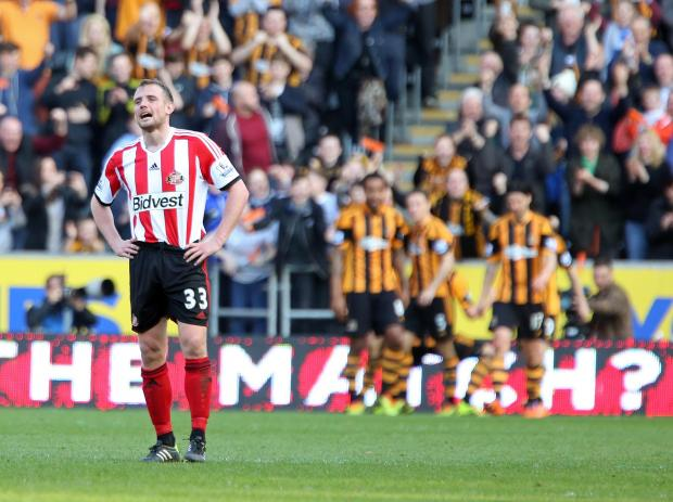 LONELY FEELING: Lee Cattermole stands and tries to come to terms with his mistake that brought about Hull's third goal as Sunderland's FA Cup hopes were extinguished. The midfielder's slack back pass set up Matty Fryatt for a simple chance