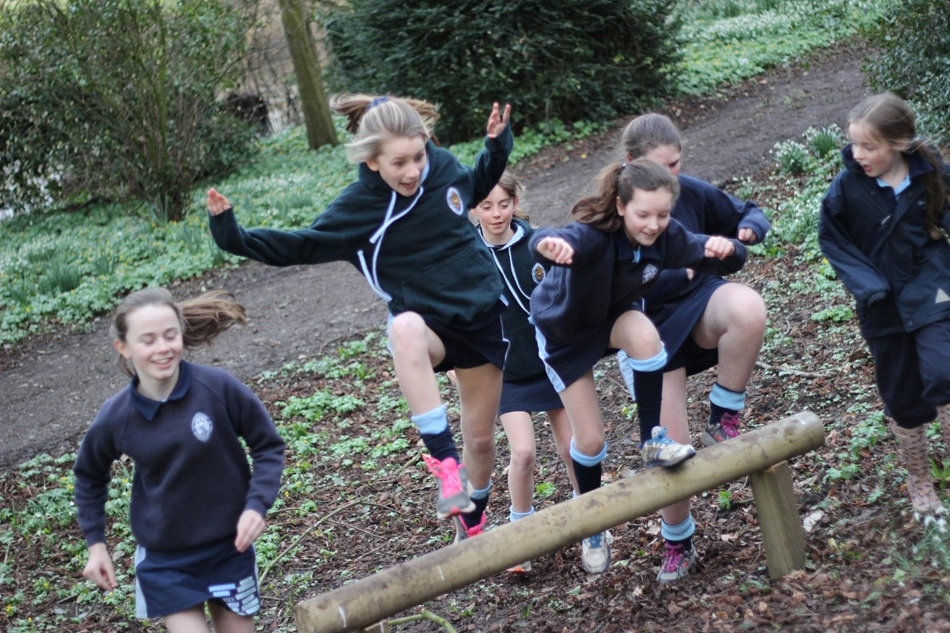 Pupils at Queen Mary's School test out the Wolf run assault course.
