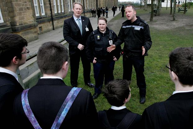 The Northern Echo: Sergeant Dave Clarke and Neighbourhood Warden Cat Cullen with Tanfield School's  assistant headteacher Ian Thompson.