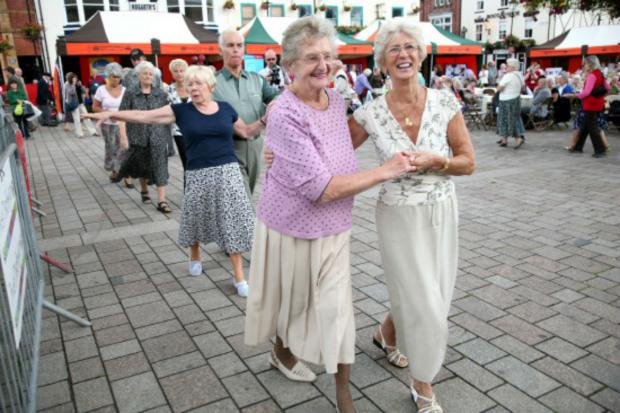 Members of Growing Older Living in Darlington enjoy a tea dance in Darlington's Market Square