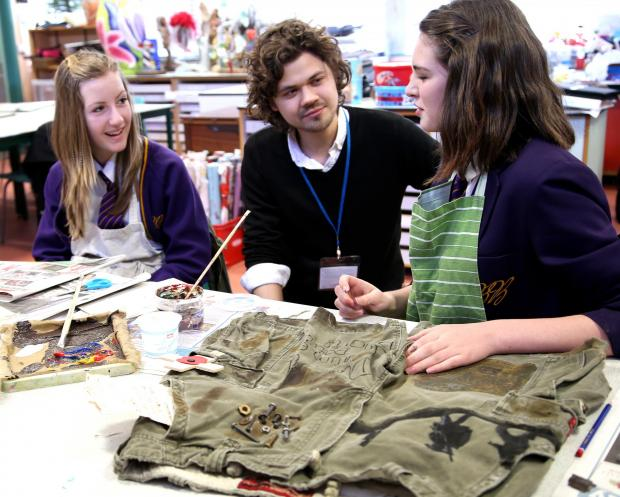 WWI THEME: Poet John Challis with pupils at Bishop Barrington School on a WW1 project, pictured here talking to Abigail Edwards, 13, (left) and Evie Bushby, 14.