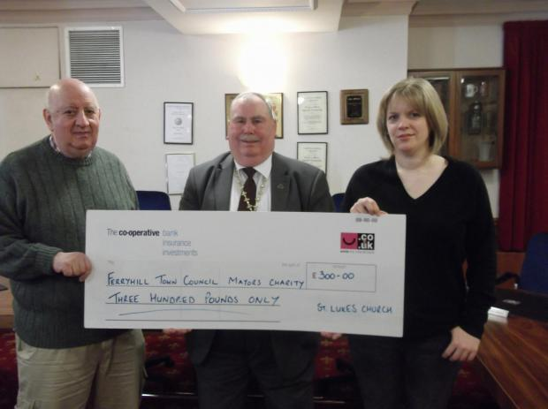 QUIDS FROM QUIZ: Rev Keith Lumsdon and Vicky Collins, who helped run the quiz, present funds to Mayor Ken Campbell