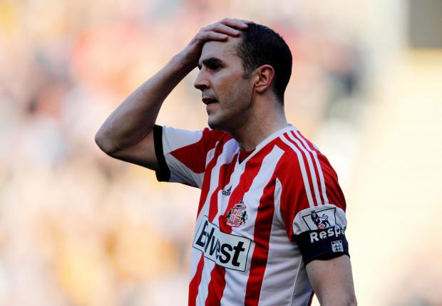 The Northern Echo: CUP WOES: John O'Shea reacts after Sunderland lose 3-0 to Hull City in the FA Cup quarter-final last week
