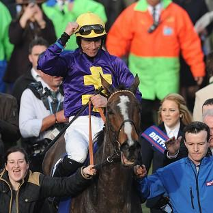 The Northern Echo: Davy Russell celebrates on Lord Windermere after winning the Gold Cup at Cheltenham