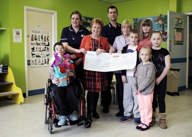 MAKING DONATION: Jean McCready presents funds to staff and children at Darlington Memorial Hospital's ward 21