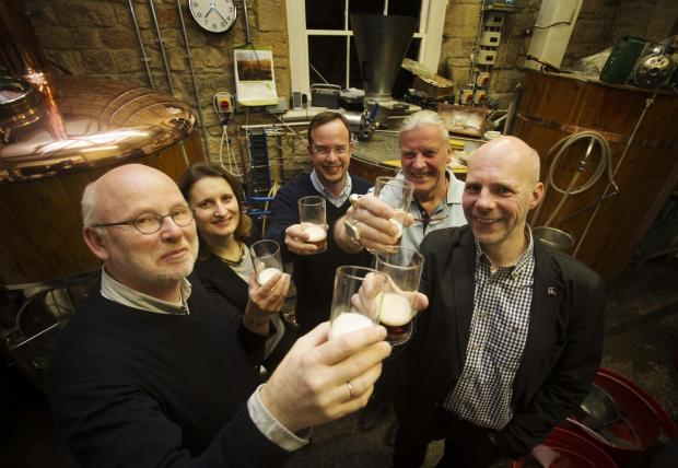 European visitors enjoy at drink at the Stables microbrewery